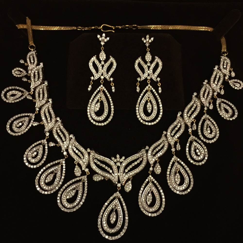 Diamonds are a girl's best friend.  One of three jewelry sets.
