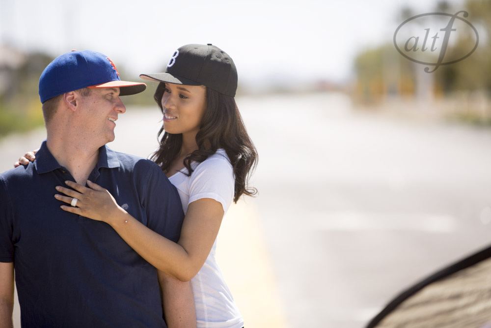 East Cost meets West Coast with these team hats in a sexy Las Vegas Engagement Photo Shoot. Las Vegas Wedding Planner Andrea Eppolito.  Alto Photography.