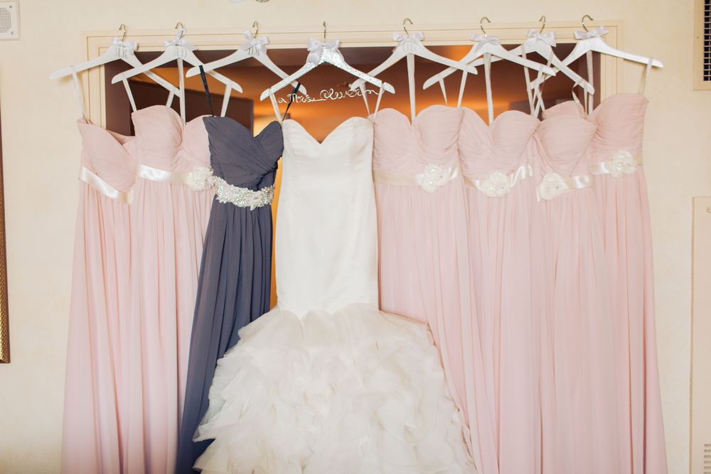 Bridesmaids wore light pink gowns, with the maid of honor wore a periwinkle purple with a custom sash.      Las Vegas Wedding Planner Andrea Eppolito  |  Wedding at Lake Las Vegas  | White and Blu  sh and Grey Wedding | Luxury Wedding Las Vegas
