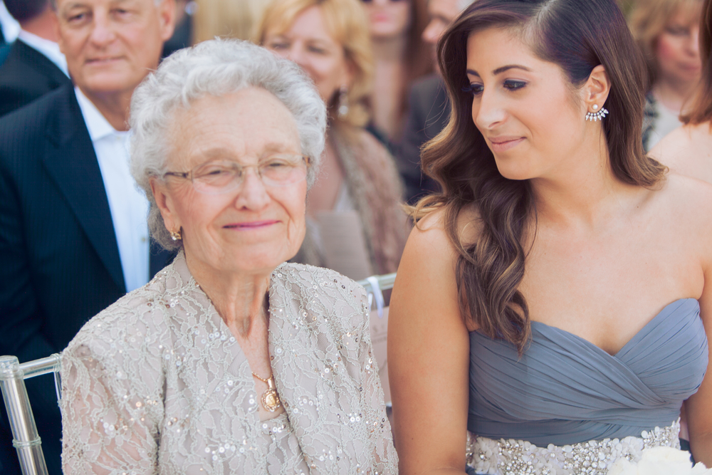The bride's beloved grandma sat with the maid of honor and bridesmaids during the wedding ceremony.      Las Vegas Wedding Planner Andrea Eppolito  |  Wedding at Lake Las Vegas  | White and Blu  sh and Grey Wedding | Luxury Wedding Las Vegas