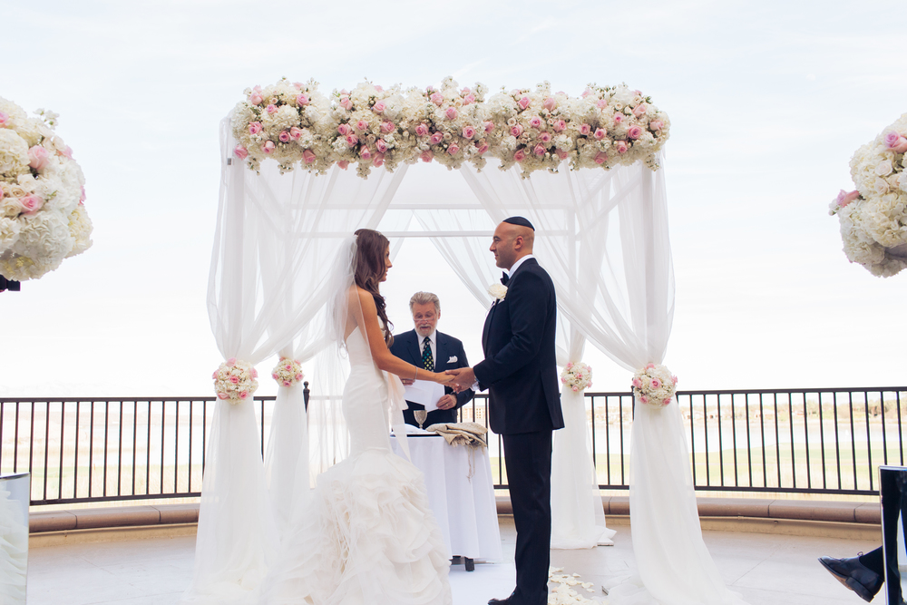 Rabbi Mel Hecht presided over the couple's interfaith ceremony.     Las Vegas Wedding Planner Andrea Eppolito  |  Wedding at Lake Las Vegas  | White and Blu  sh and Grey Wedding | Luxury Wedding Las Vegas
