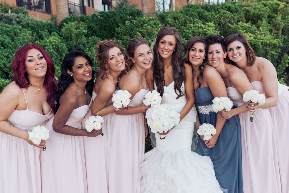 The bridesmaids wore pretty pastels and carried small nosegay bouquets of ivory roses.      Las Vegas Wedding Planner Andrea Eppolito  |  Wedding at Lake Las Vegas  | White and Blu  sh and Grey Wedding | Luxury Wedding Las Vegas