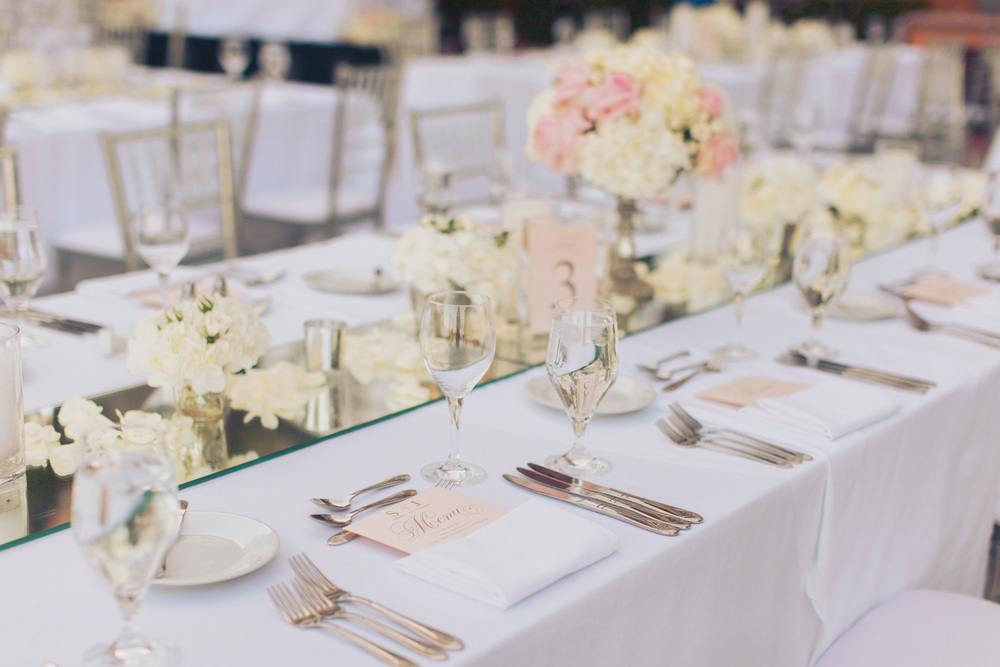 Mirrored table runners add glamour and romance, giving a sexy abs for both candles and flowers.  Blush pink personalized menus were placed at each plate setting.  Las Vegas Wedding Planner Andrea Eppolito  |  Wedding at Lake Las Vegas  | White and Blush and Grey Wedding
