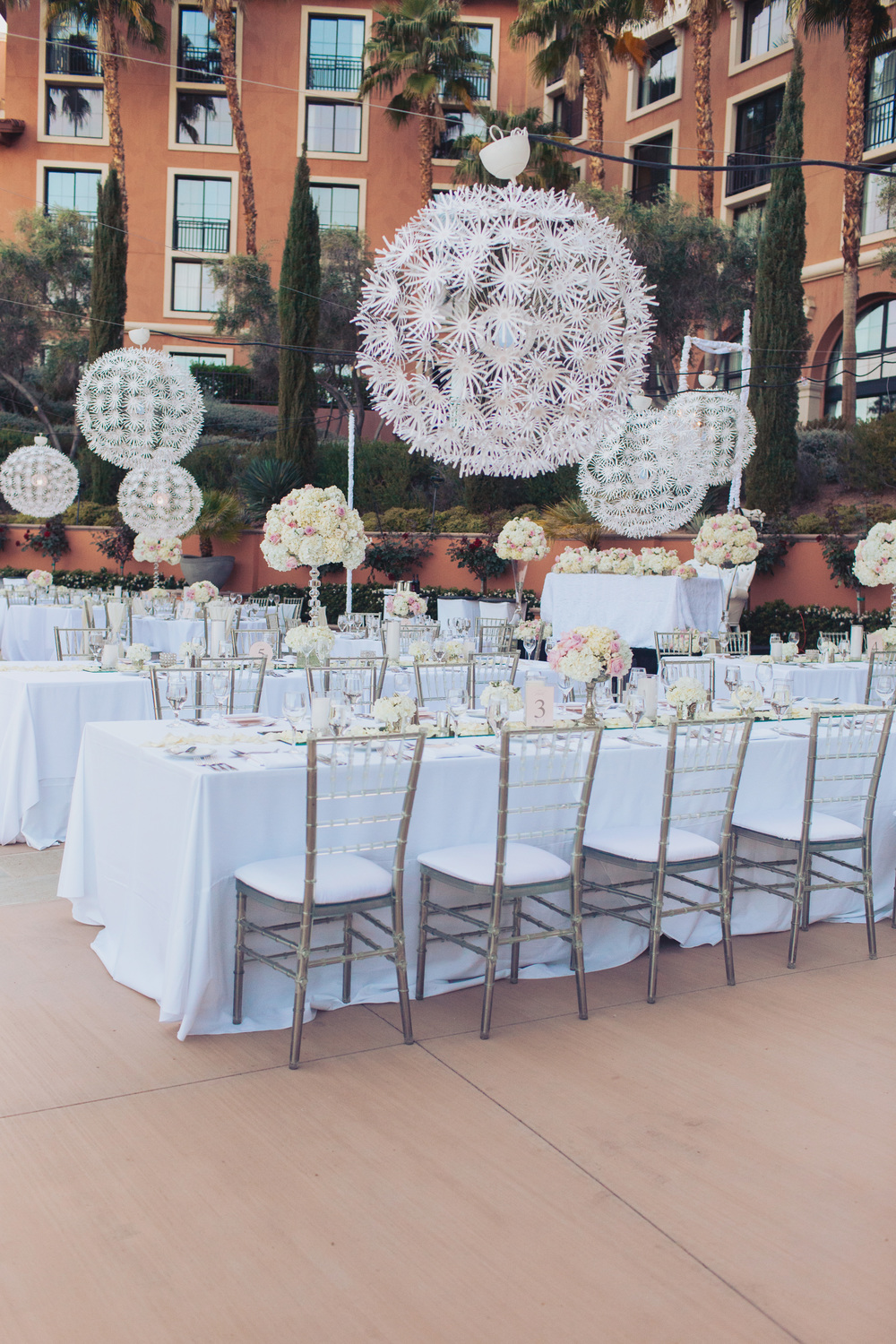 Long banquet tables were dressed with White Duping linens topped with mirrored table runners, high and low white and blush centerpieces, and scattered candles.  Lucite Chiavari Chairs with ivory cushions surrounded the tables, and pashminas were placed for the ladies if they felt a chill.  Las Vegas Wedding Planner Andrea Eppolito  |  Wedding at Lake Las Vegas  | White and Blu  sh and Grey Wedding