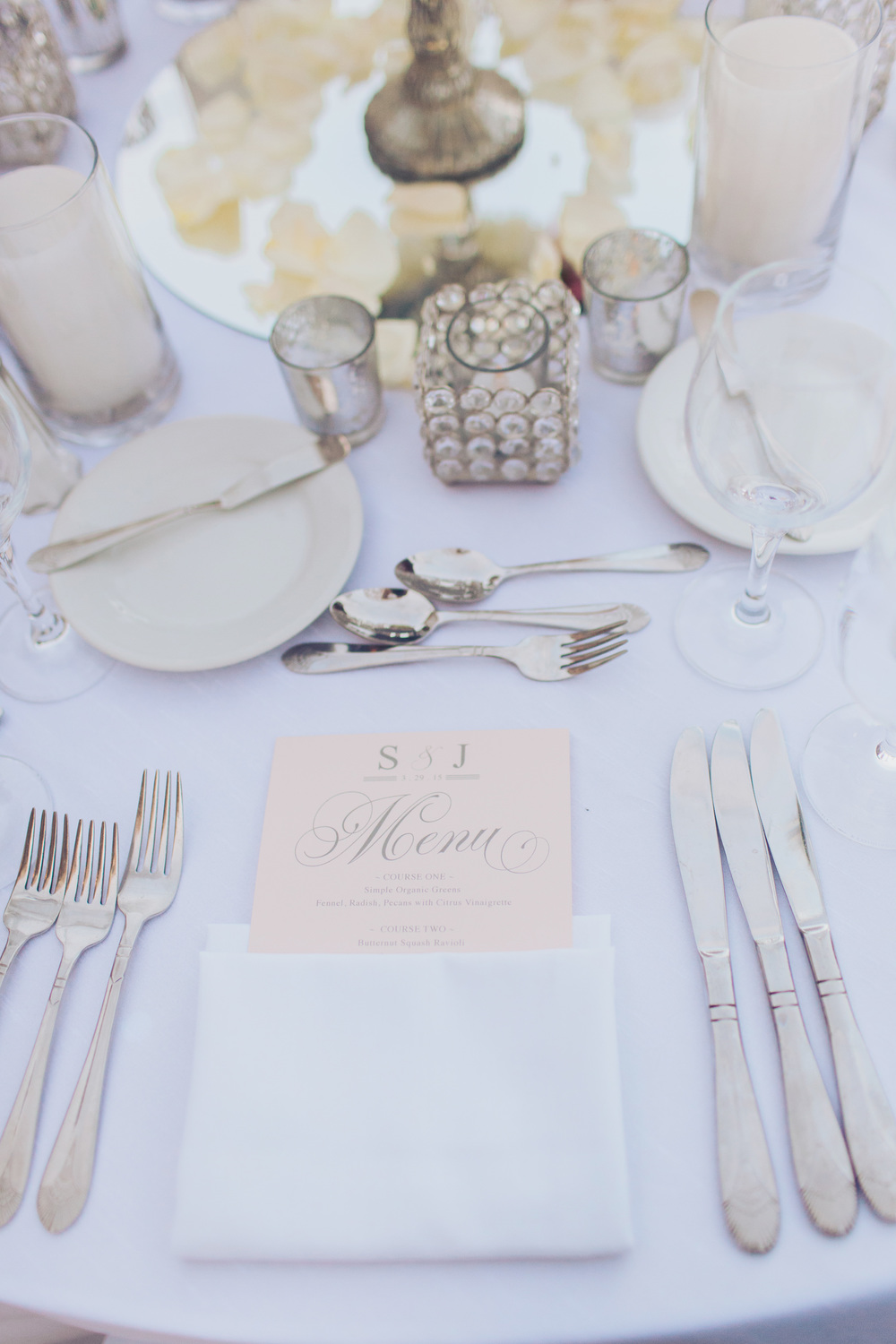The bride and groom placed their monogram on napkins, menus, table numbers, and even the dance floor.  I love the blush menus and the properly set table.   Las Vegas Wedding Planner Andrea Eppolito  |  Wedding at Lake Las Vegas  | White and Blu  sh and Grey Wedding | Luxury Wedding Las Vegas