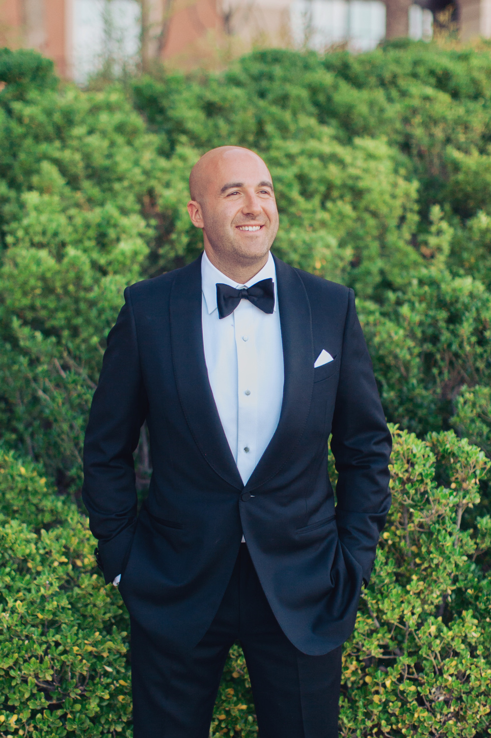 The groom wore a bespoke tuxedo by Zegna.      Las Vegas Wedding Planner Andrea Eppolito  |  Wedding at Lake Las Vegas  | White and Blu  sh and Grey Wedding | Luxury Wedding Las Vegas