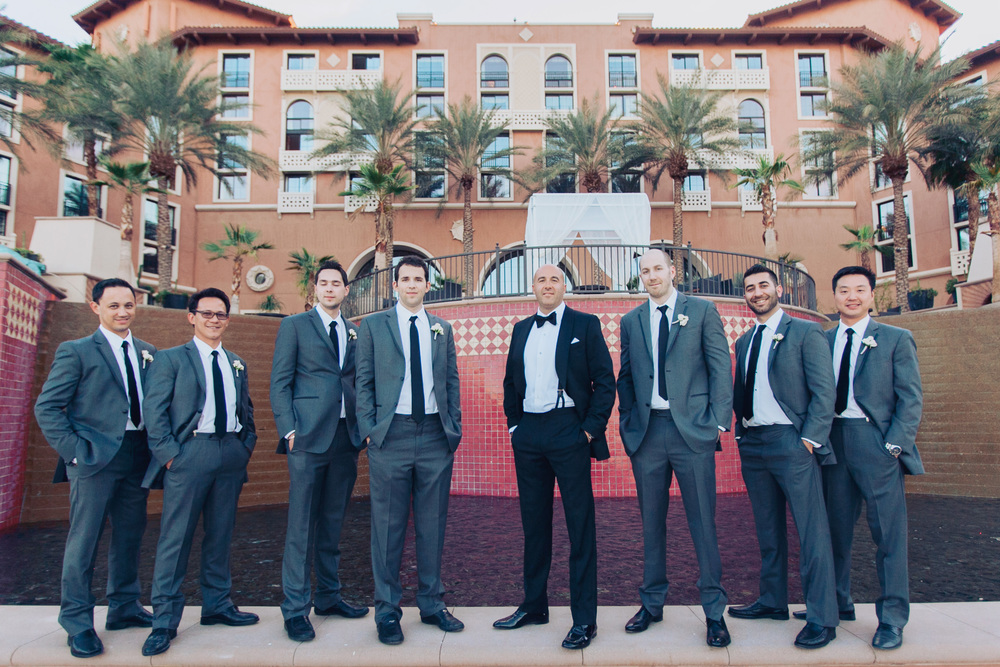 The groom wore a custom Zegna tuxedo while the groomsmen wore grey suits by Hugo Boss.      Las Vegas Wedding Planner Andrea Eppolito  |  Wedding at Lake Las Vegas  | White and Blu  sh and Grey Wedding | Luxury Wedding Las Vegas