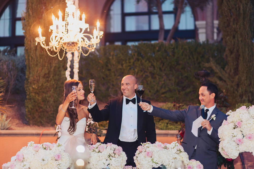 A toast to the bride and groom by the best man.   Stephanie Di Lallo married   Justin Oliver at a water front   wedding at The Westin Lake Las Vegas.       Las Vegas Wedding Planner Andrea Eppolito  |  Wedding at Lake Las Vegas  | White and Blu  sh and Grey Wedding | Luxury Wedding Las Vegas