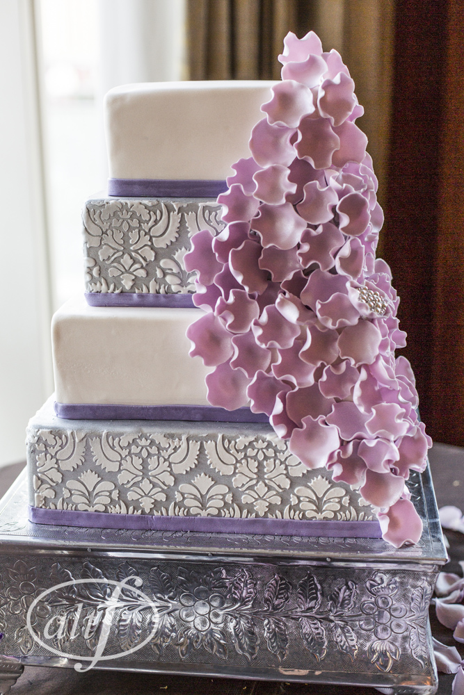 Four Tiered Wedding Cake with a Lace Overlay