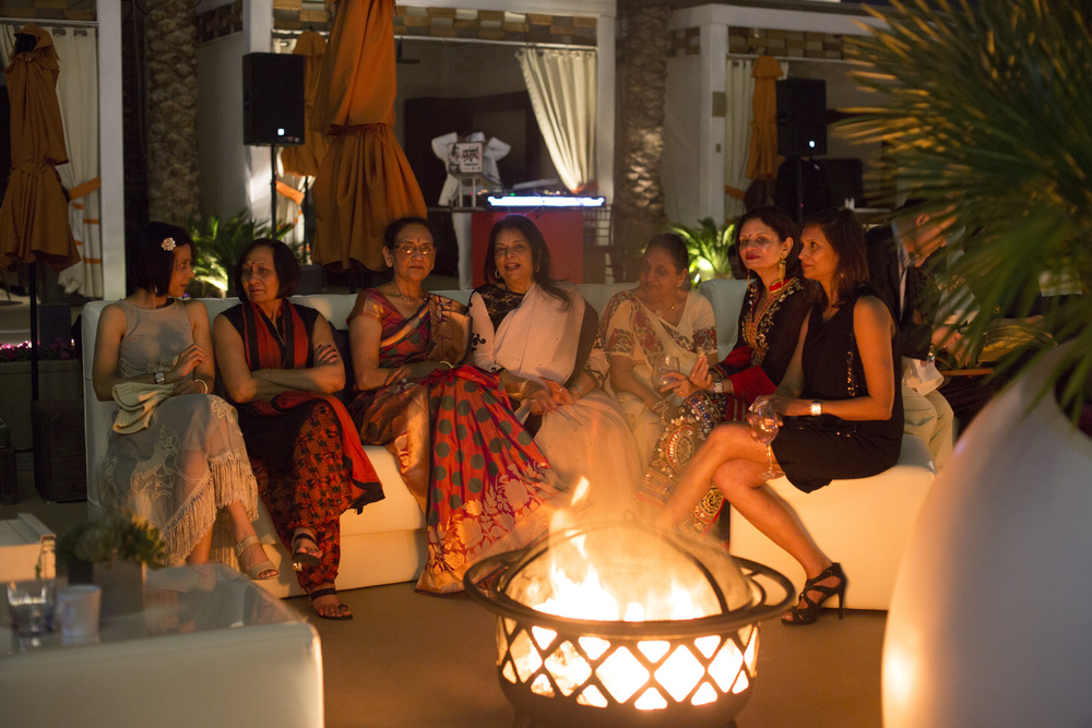 Ladies gathered around fire pits to catch up during the sangeet.   Indian Wedding at the  Mandarin Oriental   |  Las Vegas Wedding Planner  Andrea Eppolito   |  Photography by  Altf Photography   |  Video by  Something New Films   |  Floral and Decor by  Destinations by Design