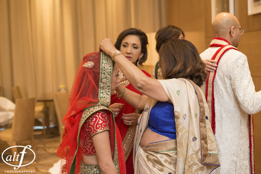 Preparing the bride for her Indian Wedding at the Mandarin Oriental.  Las Vegas Wedding Planner Andrea Eppolito.  Photo by Altf.