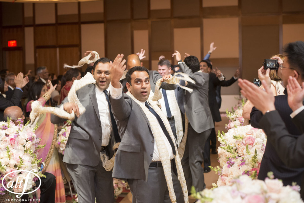 The groom's arrival at his Indian Wedding at the Mandarin Oriental.  Las Vegas Wedding Planner Andrea Eppolito.  Photo by Altf.