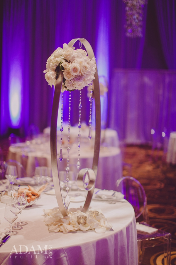 Las Vegas Wedding Planner Andrea Eppolito shares photos of   modern, tall centerpieces with white roses; taken at the   WIPA Meeting of   June 2015.