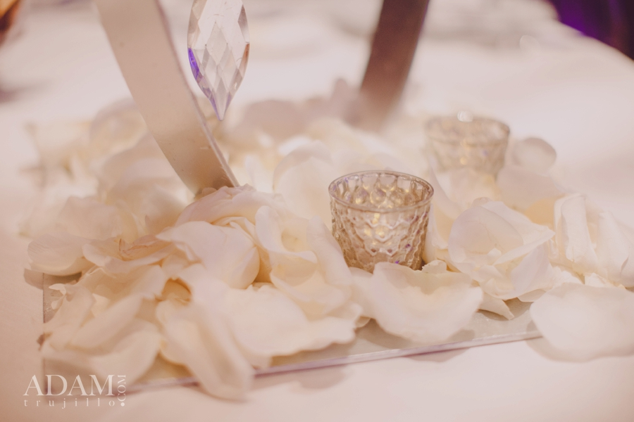 It's all about details! Don't neglect the bottom of your centerpieces.  Las Vegas Wedding Planner Andrea Eppolito shares photos of rose petals and votive candles at ARIA Las Vegas; taken at the WIPA Meeting of June 2015.