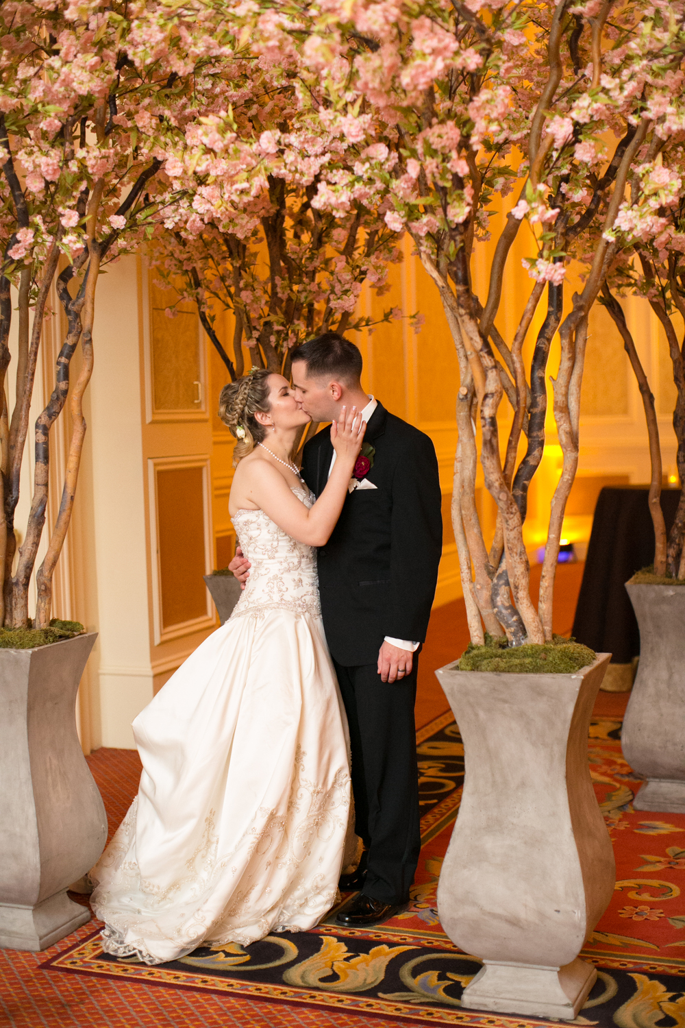 Cherry Blossoms created a romantic entrance for this wedding at The Venetian.  Las Vegas Wedding Planner Andrea Eppolito  |  Wedding at The Venetian Las Vegas  |  Florals and Decor by Naakiti Floral  |  Photos by Meg Ruth
