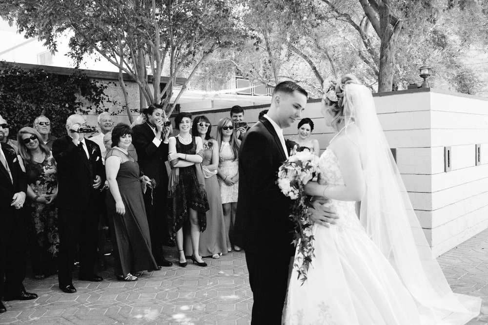 The first look took place in a garden surrounded by the bridal party. Las Vegas Wedding Planner Andrea Eppolito  |  Wedding at The Venetian Las Vegas  |  Florals and Decor by Naakiti Floral  |  Photos by Meg Ruth