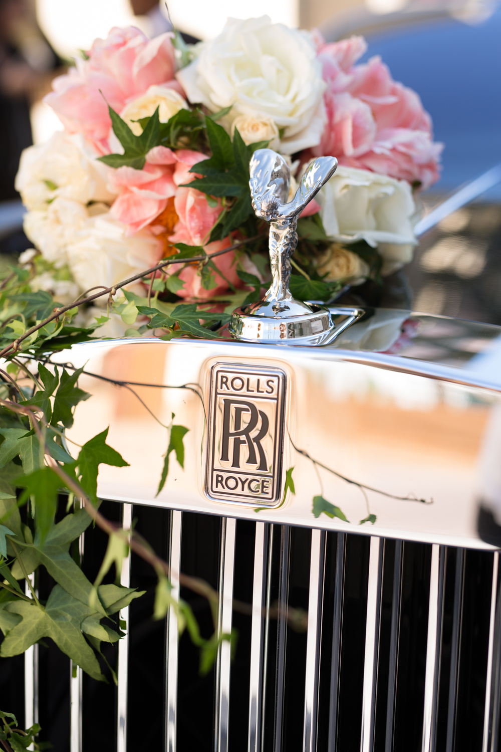 The rolls royce is the best car to leave a wedding in!  Las Vegas Wedding Planner Andrea Eppolito  |  Wedding at The Venetian Las Vegas  |  Florals and Decor by Naakiti Floral  |  Photos by Meg Ruth