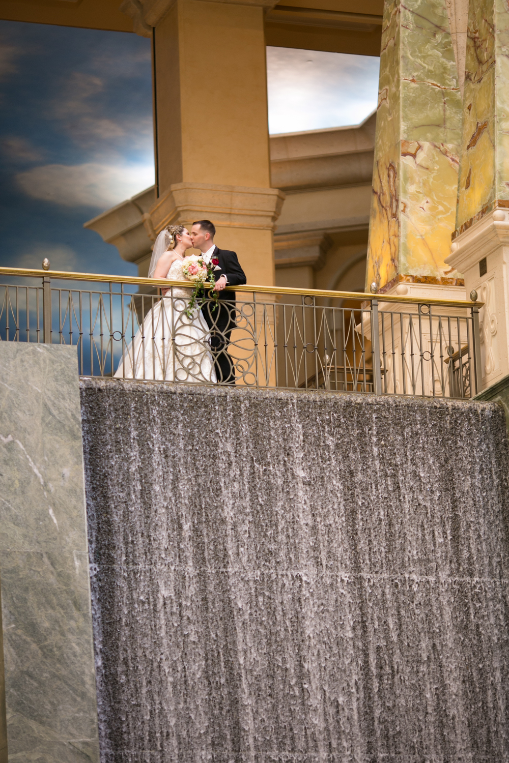 The balcony was perfect for a romantic wedding portrait. Las Vegas Wedding Planner Andrea Eppolito  |  Wedding at The Venetian Las Vegas  |  Florals and Decor by Naakiti Floral  |  Photos by Meg Ruth