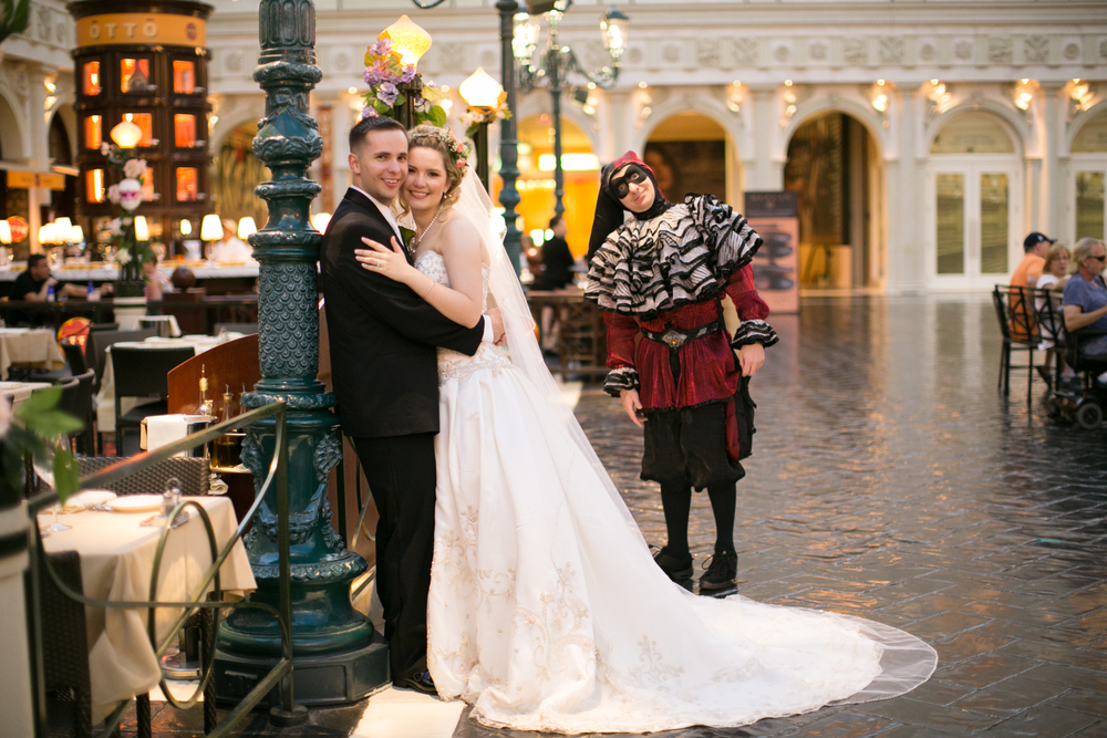 Court Jester in The Venetian.  Las Vegas Wedding Planner Andrea Eppolito  |  Wedding at The Venetian Las Vegas  |  Florals and Decor by Naakiti Floral  |  Photos by Meg Ruth