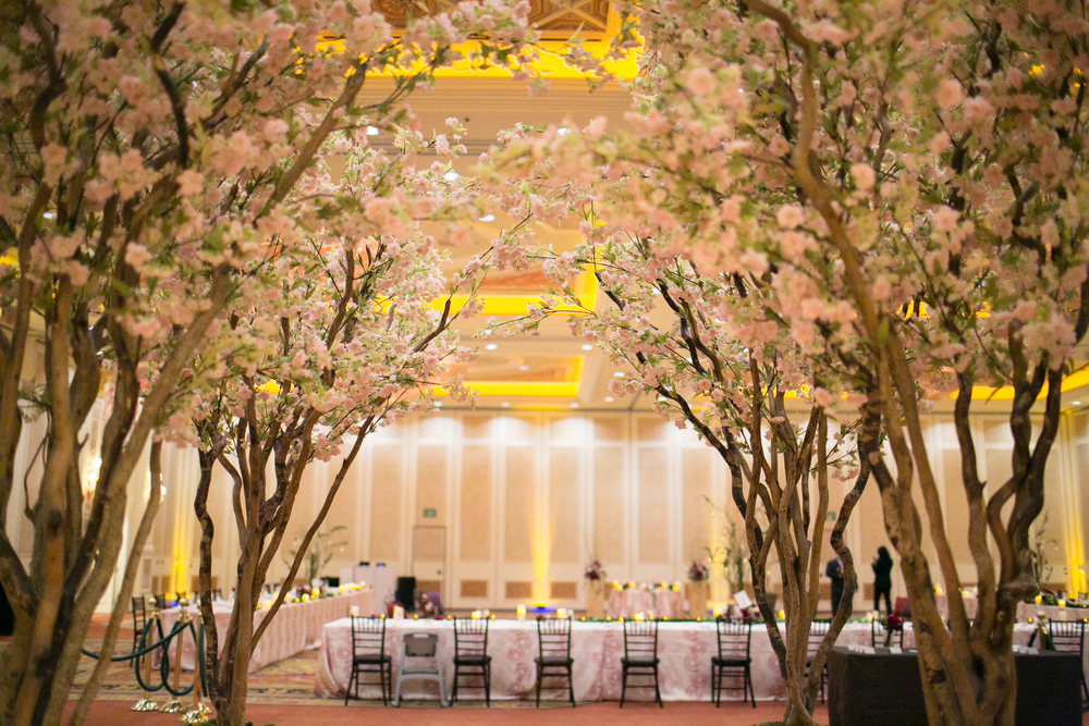 The most beautiful and romantic entry way was dressed with towering cherry blossom trees.  Las Vegas Wedding Planner Andrea Eppolito  |  Wedding at The Venetian Las Vegas  |  Florals and Decor by Naakiti Floral  |  Photos by Meg Ruth