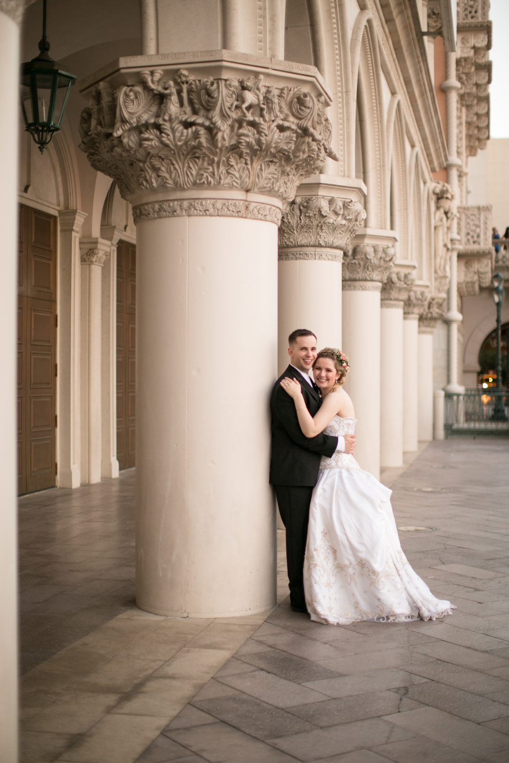 The bride and groom in front of The Venetian.   Las Vegas Wedding Planner Andrea Eppolito  |  Wedding at The Venetian Las Vegas  |  Florals and Decor by Naakiti Floral  |  Photos by Meg Ruth