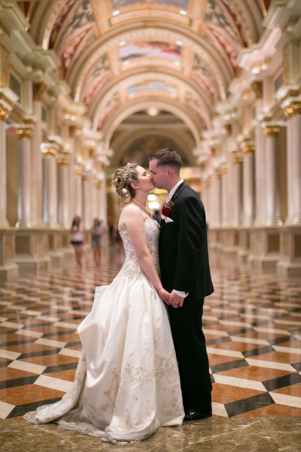 Wedding Photos in the gran hallway at the entrance of the venetian.  Las Vegas Wedding Planner Andrea Eppolito  |  Wedding at The Venetian Las Vegas  |  Florals and Decor by Naakiti Floral  |  Photos by Meg Ruth