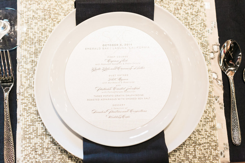 Table setting and round menu at The Art of Wedding Planning at West Elm.