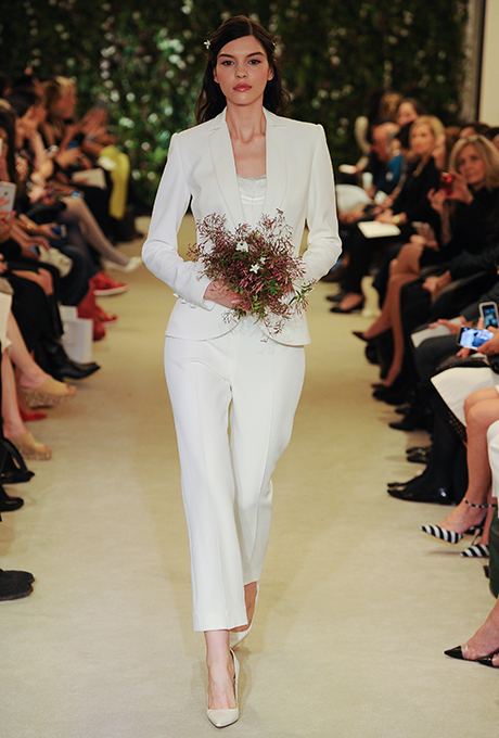 Carolina Herrera did this chic suit so right!  I love every inch of it, including the slightly cropped pants.  Photo Courtesy of Brides.com.