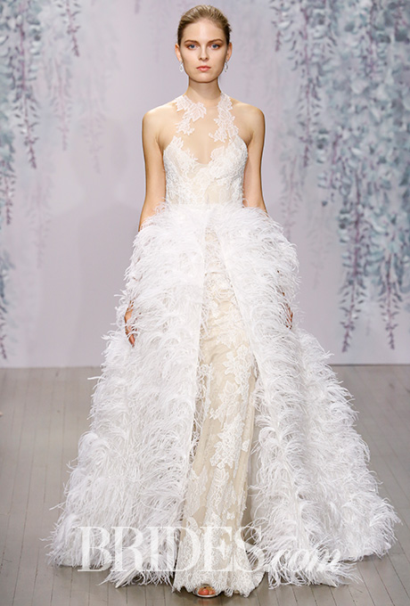 Why not add feathers to the overskirt?  Monique Lhullier.  Photo Courtesy of Brides.com