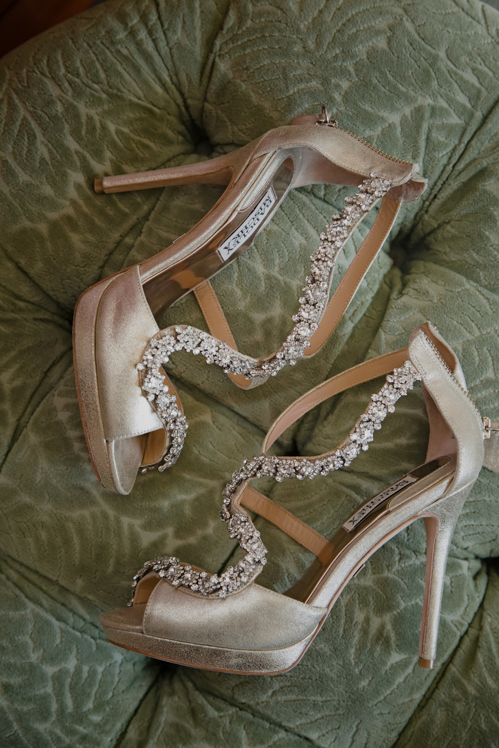 Champagne colored Badgley Mischka wedding shoes with crystal accents.   Vendor Credit:  Las Vegas Wedding Planner Andrea Eppolito | Photo: Adam Frazier Photography | Decor: Naakiti Floral | Beauty: Make Up in the 702