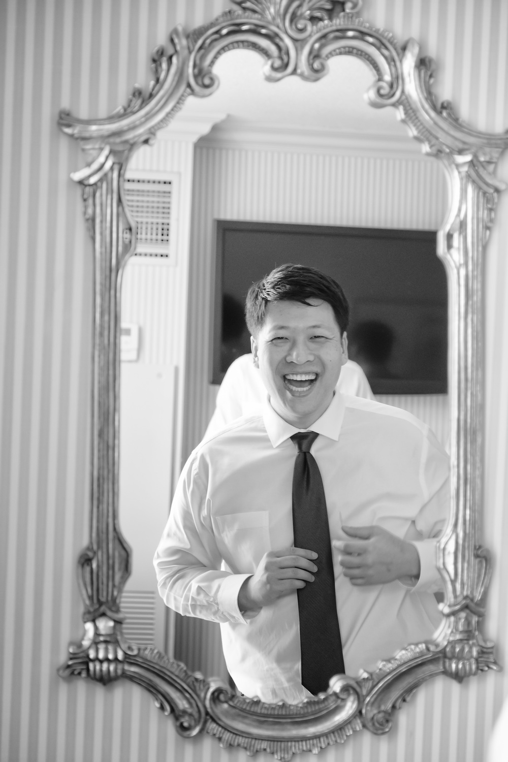 The groom had a million dollar smile on his face all day!  He was so completely joyous!  Vendor Credit:  Las Vegas Wedding Planner Andrea Eppolito | Photo: Adam Frazier Photography | Decor: Naakiti Floral | Beauty: Make Up in the 702