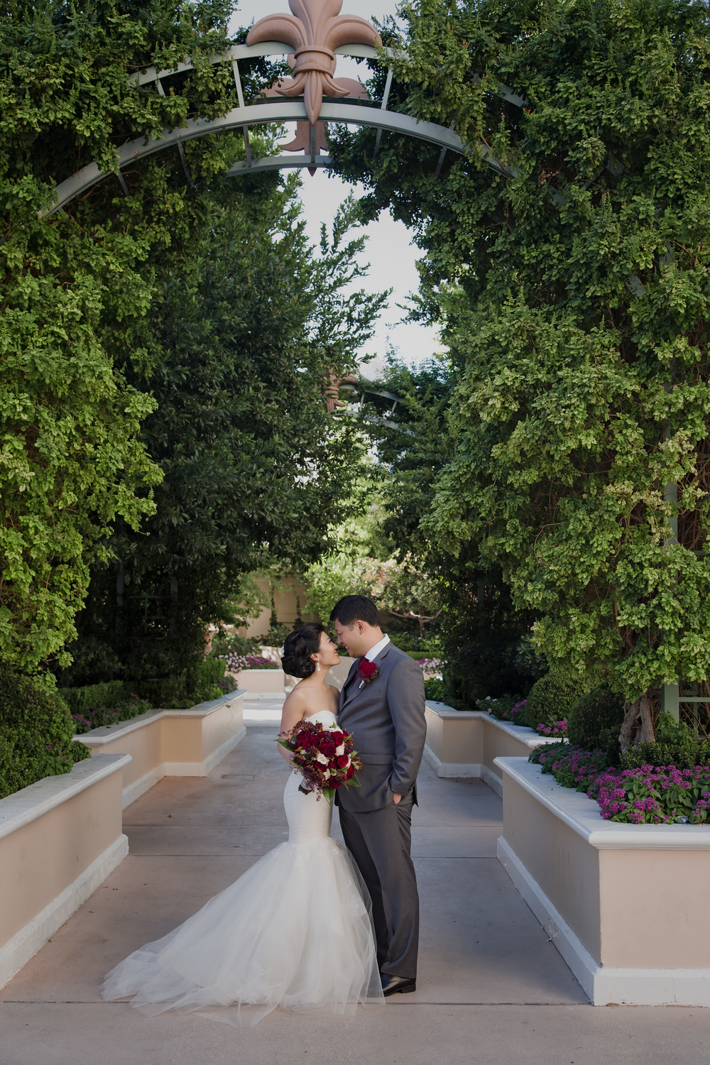 Formal wedding portraits outside are both romantic and wildly beautiful with the greenery and trees all around.  Vendor Credit:  Venue: Paris Hotel Las Vegas and Chateau | Las Vegas Wedding Planner Andrea Eppolito | Photo: Adam Frazier Photography | Decor: Naakiti Floral | Beauty: Make Up in the 702