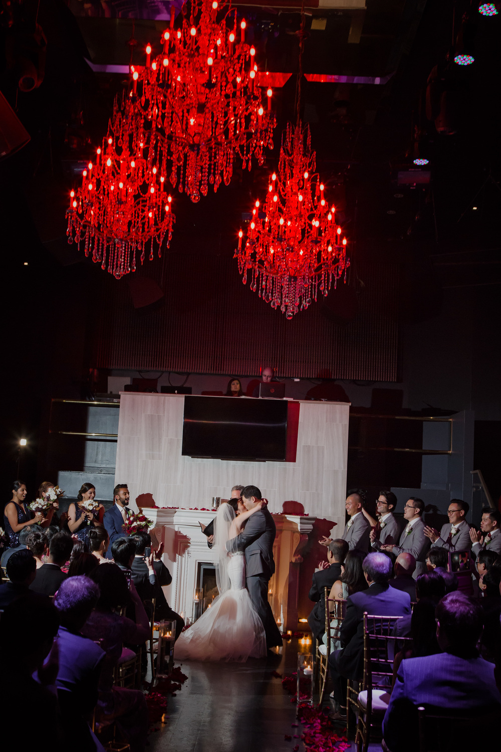 The first kiss at Chateau Nightclub in Las Vegas.   Vendor Credit:  Venue: Paris Hotel Las Vegas and Chateau | Las Vegas Wedding Planner Andrea Eppolito | Photo: Adam Frazier Photography | Decor: Naakiti Floral | Beauty: Make Up in the 702