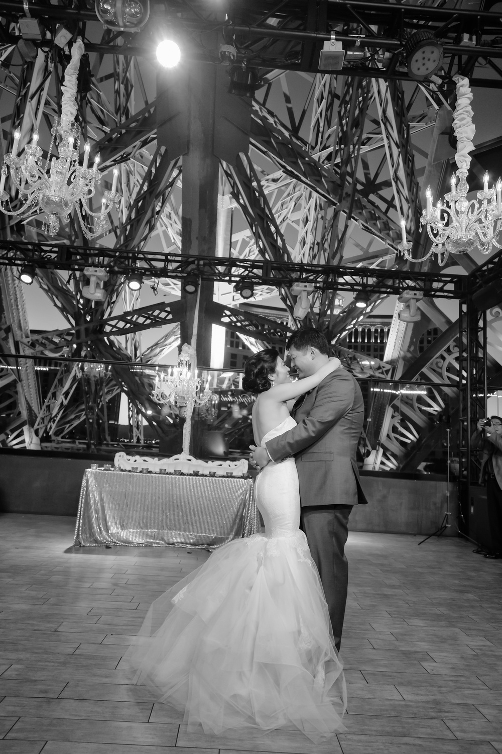Black and white photos of the first dance are especially emotional and sentimental.  Vendor Credit:  Venue: Paris Hotel Las Vegas and Chateau | Las Vegas Wedding Planner Andrea Eppolito | Photo: Adam Frazier Photography | Decor: Naakiti Floral | Beauty: Make Up in the 702