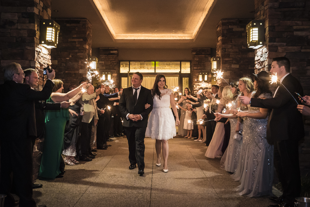 A Sparkler Exit for the bride and groom.   Las Vegas Wedding Planner Andrea Eppolito planned this wedding at Red Rock Country Club. By Dzign handled the decor shot by wedding photographer Ella Gagiano.