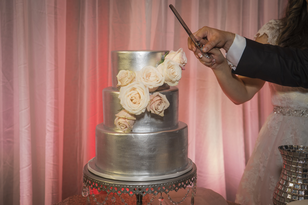 Metallic Silver Wedding Cake with Blush Roses.  Las Vegas Wedding Planner Andrea Eppolito planned this wedding at Red Rock Country Club. By Dzign handled the decor shot by wedding photographer Ella Gagiano.