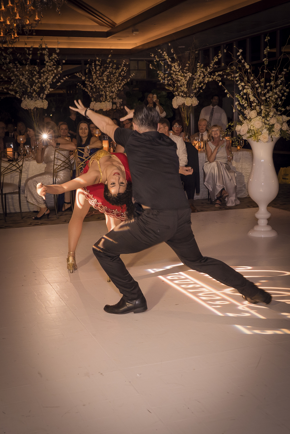 The Hora Loca is a traditional Cuban dance meant to keep the party going and bring guests to the dance floor.  Las Vegas Wedding Planner Andrea Eppolito planned this wedding at Red Rock Country Club. By Dzign handled the decor shot by wedding photographer Ella Gagiano.