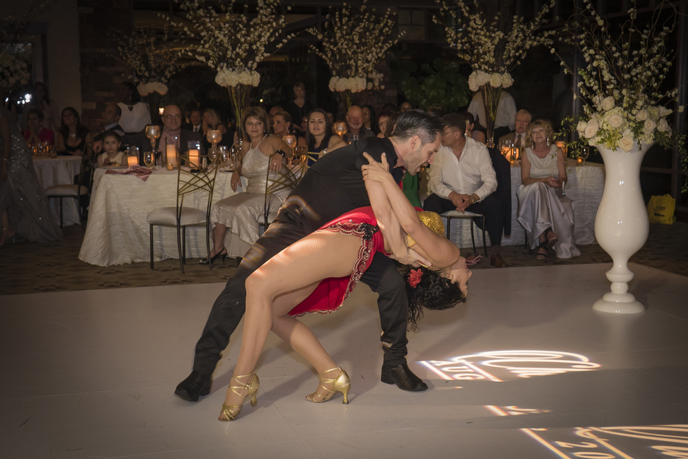 Wedding guests were entertained by sexy salsa dancers.  Las Vegas Wedding Planner Andrea Eppolito planned this wedding at Red Rock Country Club. By Dzign handled the decor shot by wedding photographer Ella Gagiano.