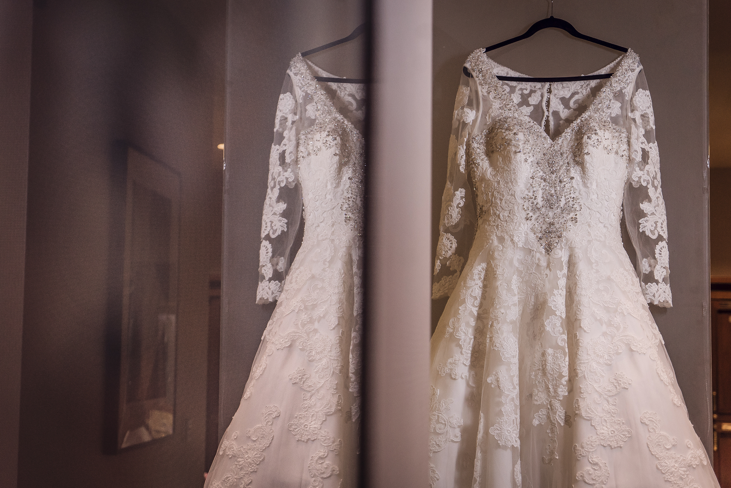 b6b4449557722 Allure Couture Wedding Gown customized with the addition of sleeves and  hand placed Swarovski crystals.