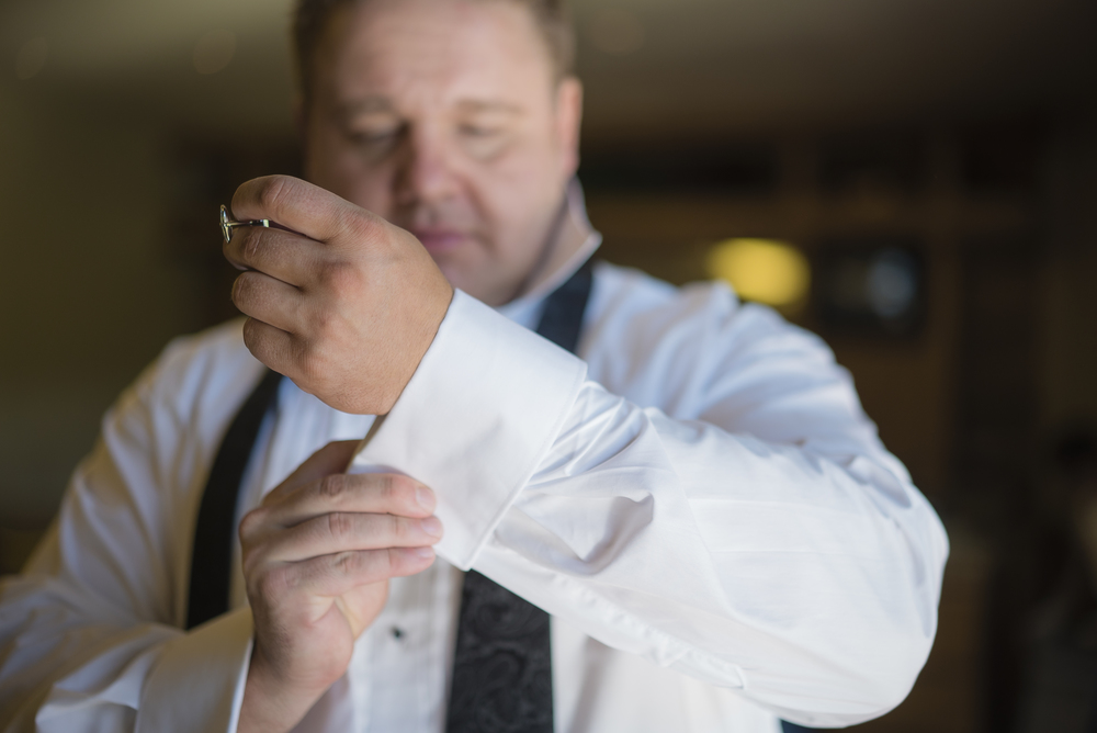 The groom added cufflinks to his Hugo Boss tuxedo.  Las Vegas Wedding Planner Andrea Eppolito designed this luxury wedding at Red Rock Country Club. By Dzign handled the decor shot by wedding photographer Ella Gagiano.