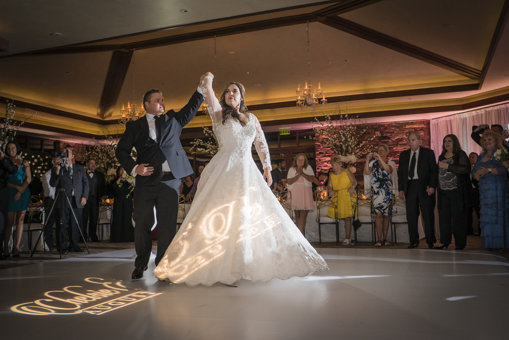 Choreographed first dance in Las Vegas.   Las Vegas Wedding Planner Andrea Eppolito designed this luxury wedding at Red Rock Country Club. By Dzign handled the decor shot by wedding photographer Ella Gagiano.