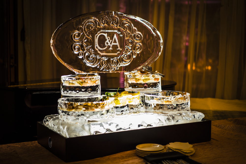 Ice carving raw bar in Las Vegas.  Las Vegas Wedding Planner Andrea Eppolito designed this luxury wedding at Red Rock Country Club. By Dzign handled the decor shot by wedding photographer Ella Gagiano.