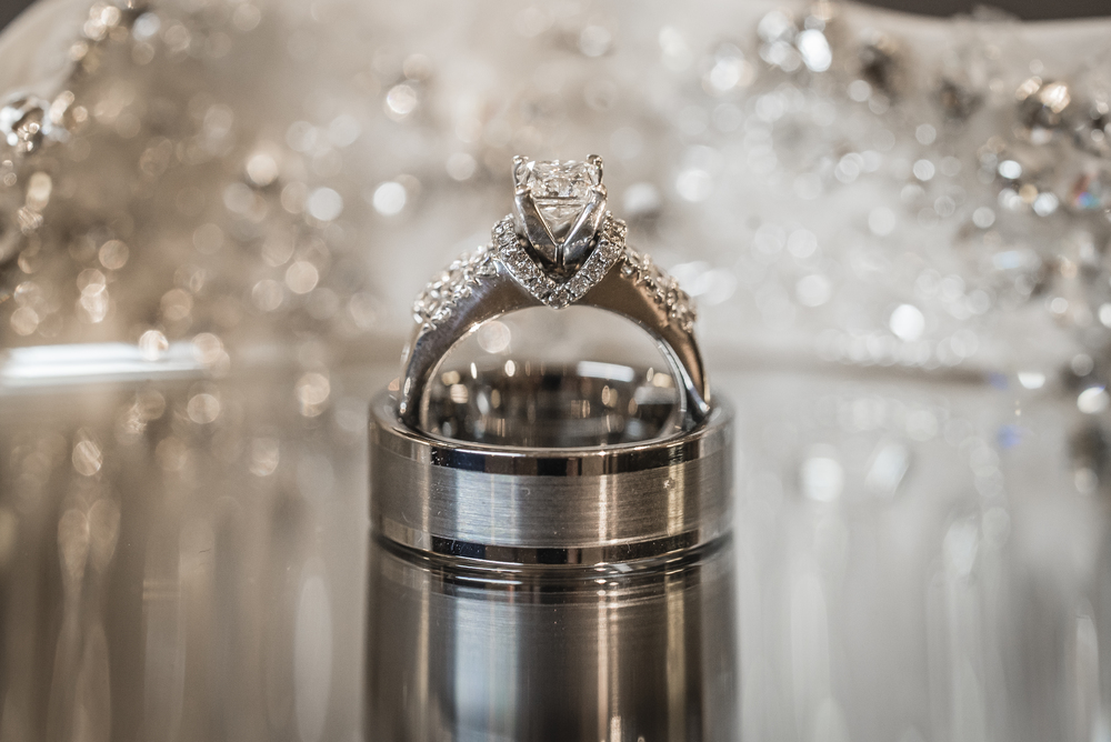 Engagement ring and groom's wedding band.  Las Vegas Wedding Planner Andrea Eppolito designed this luxury wedding at Red Rock Country Club. By Dzign handled the decor shot by wedding photographer Ella Gagiano.