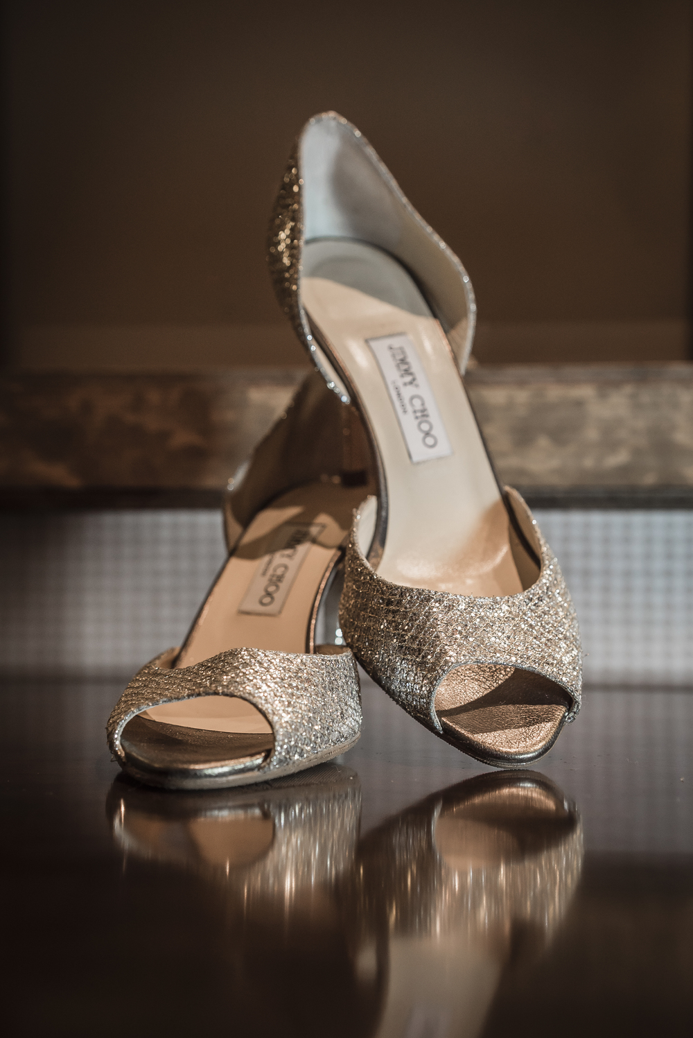 Tall brides looking for short heels love these Jimmy Choo bridal shoes.  Las Vegas Wedding Planner Andrea Eppolito designed this luxury wedding at Red Rock Country Club. By Dzign handled the decor shot by wedding photographer Ella Gagiano.