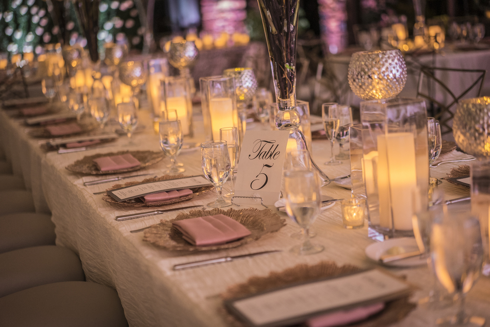 Long tables featured alternating place settings.  Las Vegas Wedding Planner Andrea Eppolito designed this luxury wedding at Red Rock Country Club. By Dzign handled the decor shot by wedding photographer Ella Gagiano.