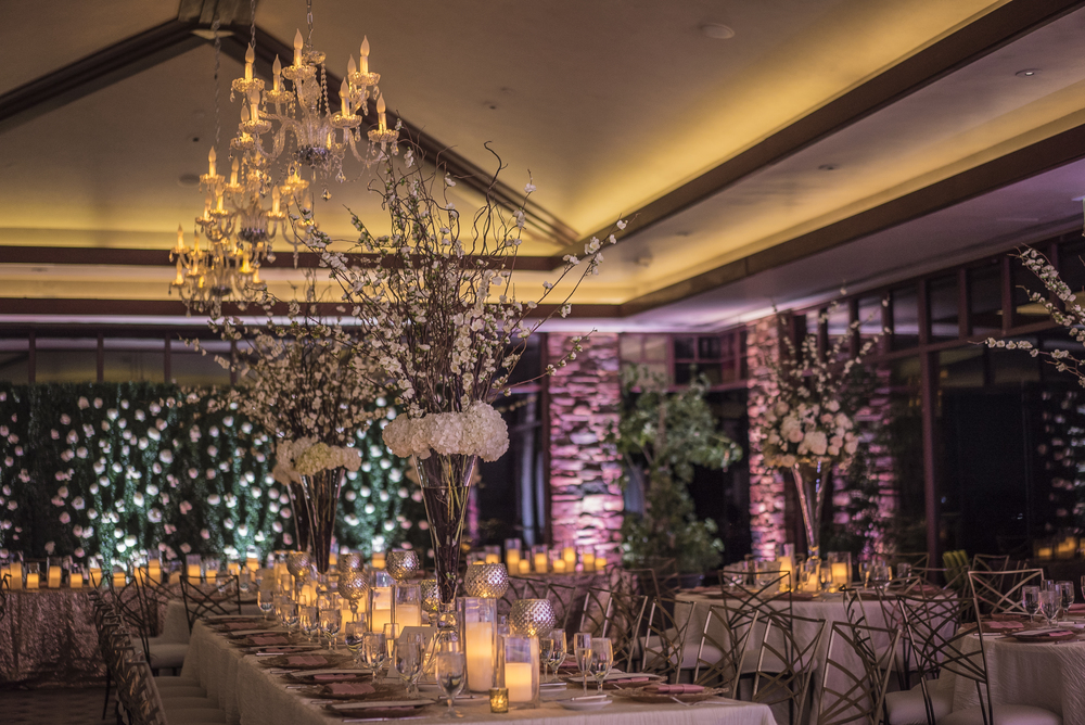 Alternate round and long tables for an interesting seating.  Las Vegas Wedding Planner Andrea Eppolito designed this luxury wedding at Red Rock Country Club. By Dzign handled the decor shot by wedding photographer Ella Gagiano.