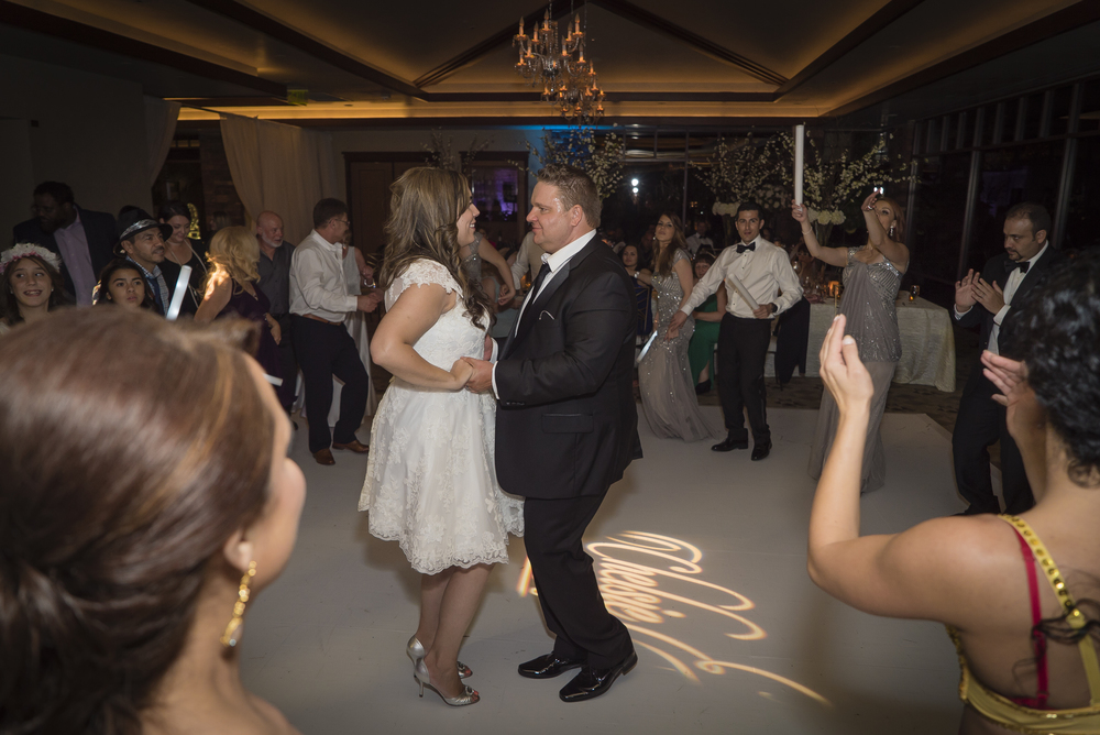 Bride wears second reception dress for dancing.  Las Vegas Wedding Planner Andrea Eppolito designed this luxury wedding at Red Rock Country Club. By Dzign handled the decor shot by wedding photographer Ella Gagiano.