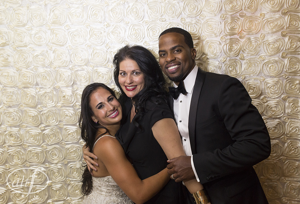 Anna Lyssa & DJ Johnson pose with Las Vegas Wedding Planner Andrea Eppolito in the Joy Squad Photo Booth.