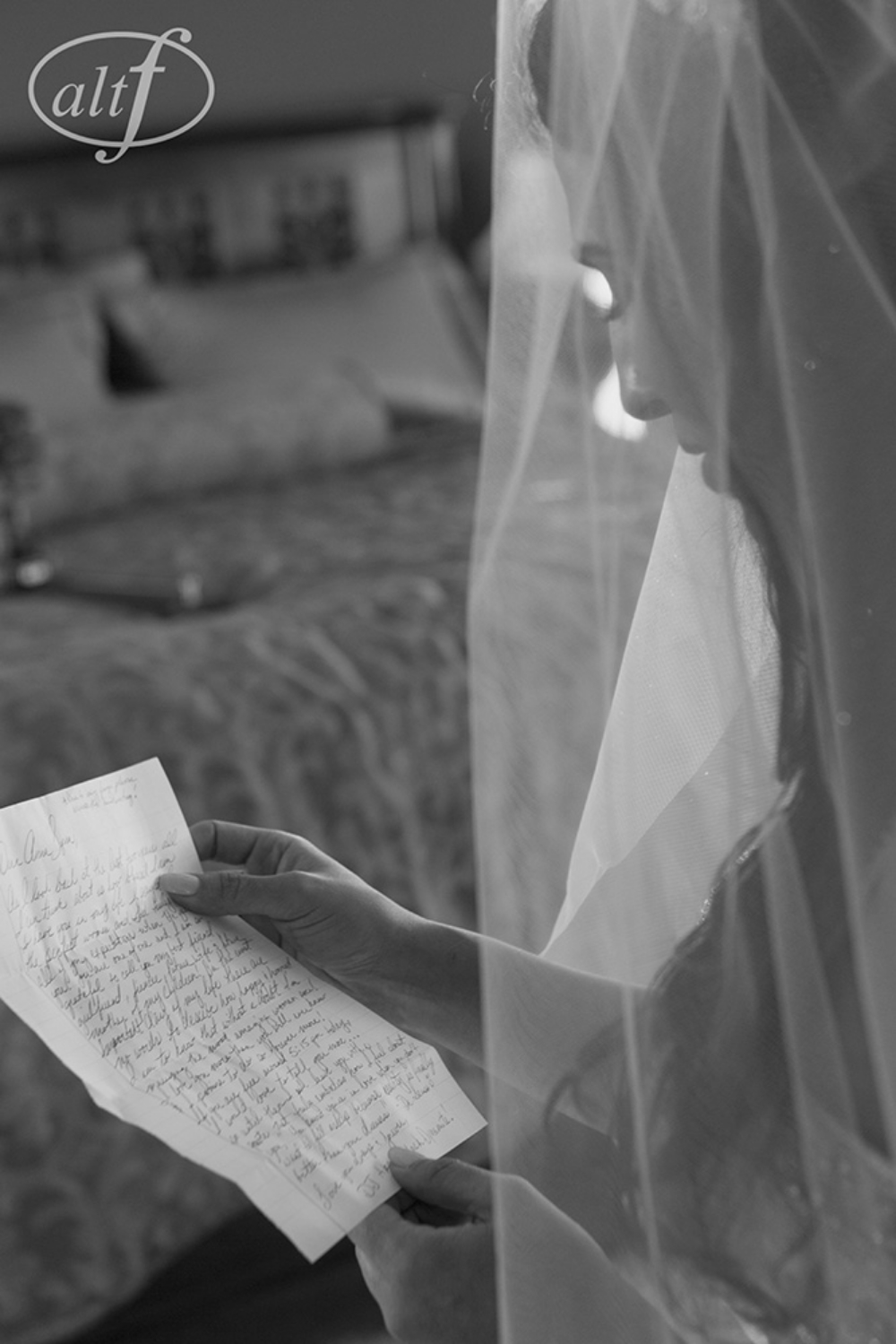 The bride received a love letter from the groom.  Black and white photo. Las Vegas Wedding Planner Andrea Eppolito.  Image by Altf.com.