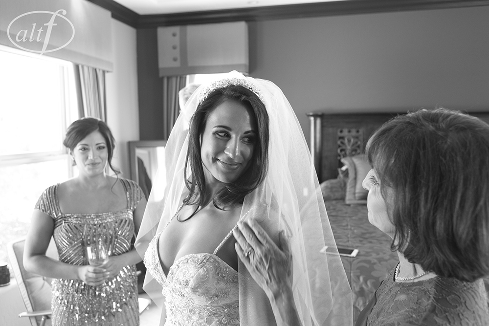 Tender moment between the bride and the mother of the bride.  Las Vegas Wedding Planner Andrea Eppolito.  Image by Altf.com.